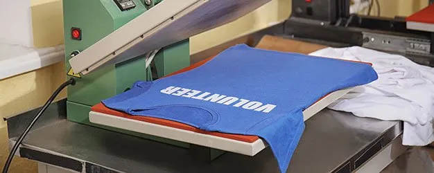 Photo of shirt being screen printed